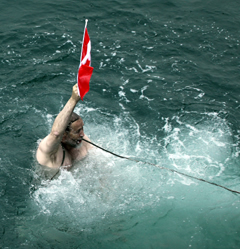 Jim Halfpenny into Arctic ocean with Canadian flag